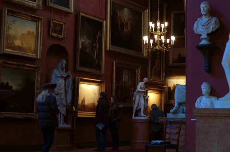 mr.turner an exhibition at petworth house - hogarth lighting picture lights illuminating the Turner oil paintings