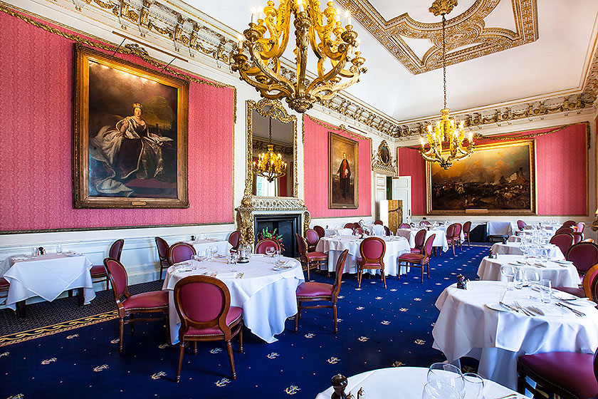 in and out club naval military club st james london interior shot of Hogarth picture lights large dining room