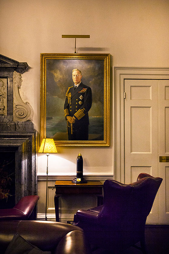 in and out club naval military club st james london interior shot of Hogarth picture lights painting of duke