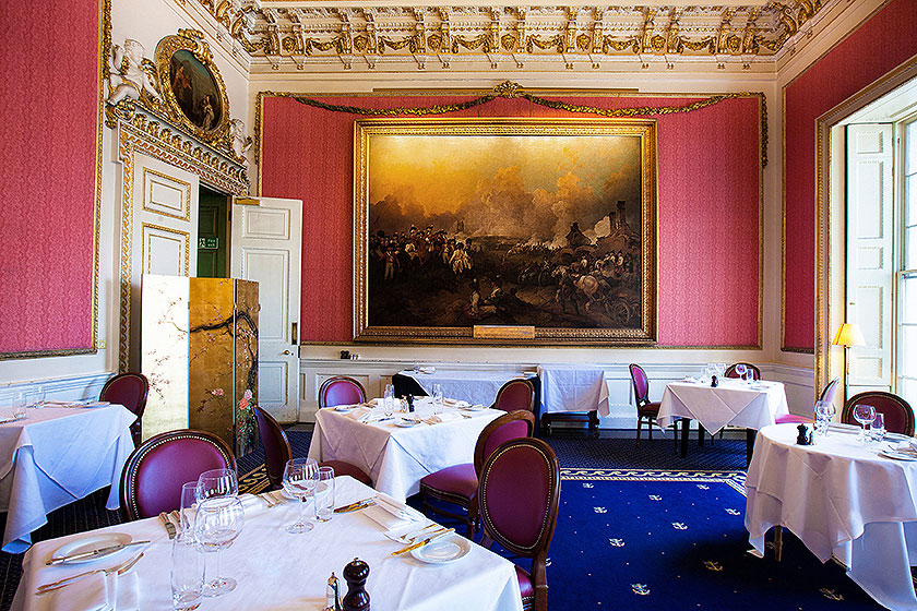in and out club naval military club st james london interior shot of Hogarth picture lights large painting