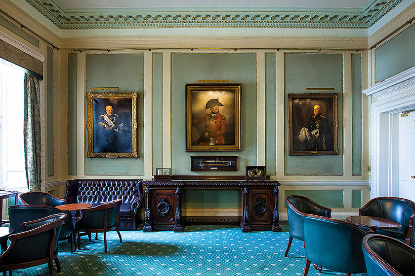 in and out club naval military club st james london interior shot of Hogarth picture lights