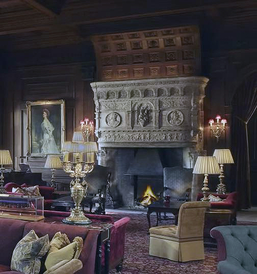 The Hall showing the fireplace and portrait of Nancy Astor