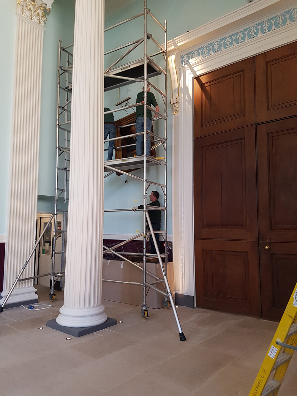 worcester college oxford paintings being hung with hogarth picture lights attached
