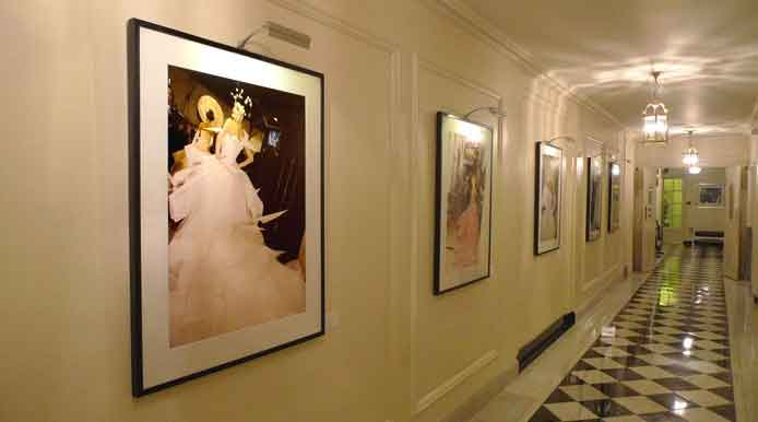 Galliano hallway at Claridges photographs lit by Hogarth rechargeable battery picture lights