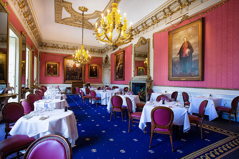 in and out club, naval and military club london. Install hogarth picture lights