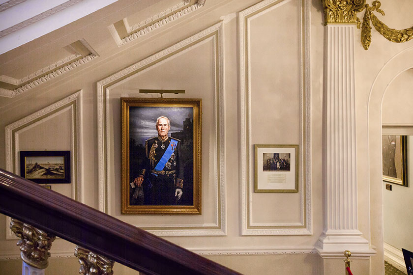 large portraits in the in and out club, london with hogarth classic picture lights