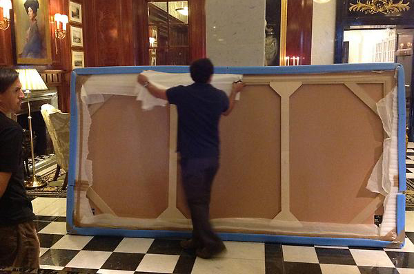savoy artwork being installed by hogarth picture lights